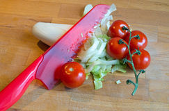 Preparing some salad. With tomatoes and chicory Stock Images