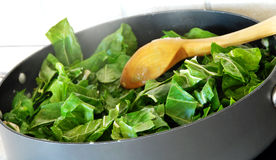 Preparing spinach Stock Photo