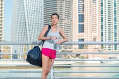 Preparing for sports exercises. Athletic woman in sportswear hol Royalty Free Stock Images
