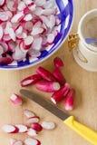 Preparing spring radish salad. Enjoying spring – preparing salad or pickles from fresh radish Stock Image