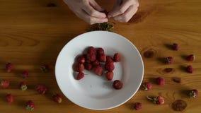 Preparing strawberries for making jam stock video footage