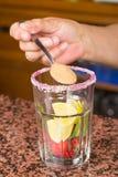 Preparing a strawberry mojito Royalty Free Stock Image