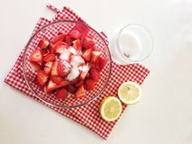 Preparing strawberry with sugar Stock Images