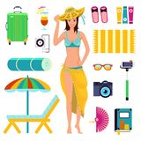 Preparing for summer beach holiday, to vacation. A girl in bathing suit with elements of beach rest Royalty Free Stock Photo