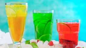 Preparing Summer Spritzer drinks with fresh fruit with sparkling mineral water. Preparing Summertime Spritzer drinks with fresh fruit, mango, berries, cucumbers Royalty Free Stock Photography