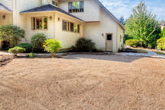 Preparing surface for stone patio. Dirt smoothed and leveled in preparation for laying stone patio Royalty Free Stock Images
