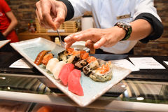 Preparing sushi plate. Royalty Free Stock Images