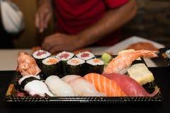 Preparing sushi platter Stock Photos
