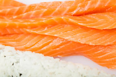 Preparing sushi roll, roll and salmon Stock Photos