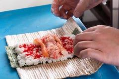 Preparing sushi rolls Royalty Free Stock Photo