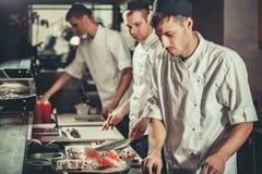 Preparing sushi set in restaurant kitchen Stock Photos