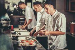 Preparing sushi set in restaurant kitchen Royalty Free Stock Images