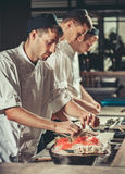 Preparing sushi set in restaurant kitchen Royalty Free Stock Photography