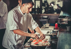 Preparing sushi set in restaurant kitchen Royalty Free Stock Photo