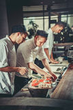 Preparing sushi set in restaurant kitchen Royalty Free Stock Photos