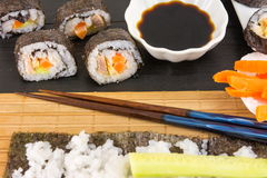 Preparing sushi. Sushi rolls and chopsticks Stock Photos