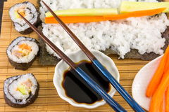 Preparing sushi. Sushi rolls and chopsticks Stock Photography