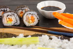 Preparing sushi. Sushi rolls and chopsticks Royalty Free Stock Photography