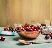 Preparing of Sweet cherry preserve,  homemade jam or  jelly on rustic kitchen background Stock Photo