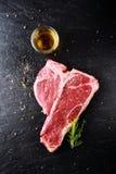 Preparing a t-bone steak for grilling Stock Image