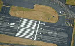 Preparing for Takeoff - Aerial. Airplane holds short of the runway for departure Royalty Free Stock Images