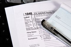 Preparing Taxes - Check and Forms on Keyboard Royalty Free Stock Photo