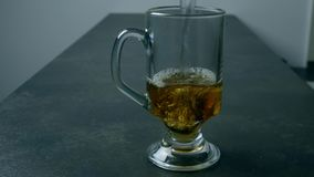 Preparing tea. Pouring a cup of tea. Preparing tea. Pouring a cup of tea in the glass with hot water stock video footage