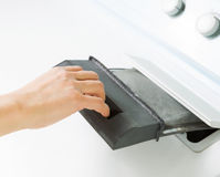 Preparing to Clean Air Filter Screen in Dryer Machine Stock Photography