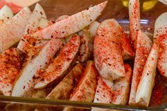 Free Preparing To Cook Potato Wedges With Chili And Paprika, Colorful Food Royalty Free Stock Photography - 147442027