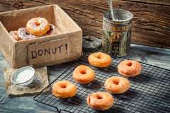 Preparing to decorate donuts with icing sugar Royalty Free Stock Images
