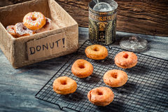 Preparing to decorate donuts with icing sugar Stock Photo