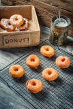 Preparing to decorate donuts with icing sugar Stock Photography