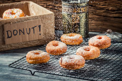 Preparing to decorate donuts with powder sugar Stock Photography