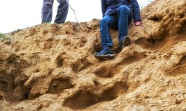 Preparing to descend from a sandy slope. Man is preparing to descend from a sandy slope Royalty Free Stock Photos