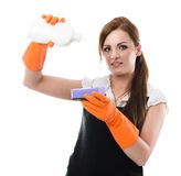 Preparing to dishwashing. Woman in rubber gloves applying  dishwashing liquid to a sponge - preparing to dishwashing Stock Photo