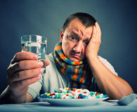 Preparing to eat medicines Stock Image