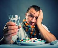 Preparing to eat medicines Stock Image