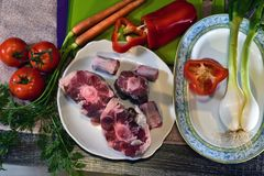 Preparing to eat,. Oxtail, pepper, carrots, tomato, meat, raw, cooking, Cordovan recipe, tasty, delicious, gastronomy, gourmet, vegetables Royalty Free Stock Photos