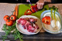 Preparing to eat. Oxtail, pepper, carrots, tomato, meat, raw, cooking, Cordovan recipe, tasty, delicious, gastronomy, gourmet, vegetables Royalty Free Stock Image