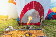 Preparing to the evening flight of the hot air balloons. Royalty Free Stock Photo