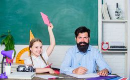 Preparing to exams. back to school. Private teaching. small girl child with bearded teacher man in classroom. daughter stock photo
