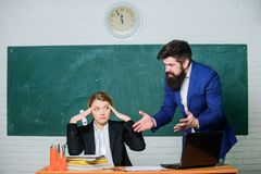 Preparing to exams together. back to school. Informal education. businessman and tired secretary. business couple use. Laptop and documents. paper work. office royalty free stock image