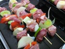 Three fresh raw pork skewers. Preparing to fry Stock Images