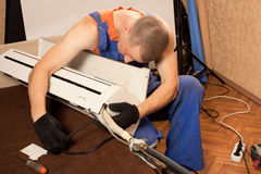 Preparing to install new air conditioner stock photos