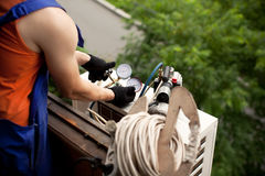 Preparing to install new air conditioner stock photo