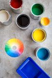 Preparing to painting. Paints, palette and tray on grey stone background top view Stock Photography