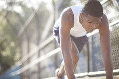 Preparing to run. Young male preparing to run on urban path Royalty Free Stock Images