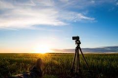 Preparing to shoot the sun going beyond the horizon stock image