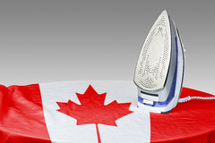 Preparing to smooth out the wrinkles of Flag-Canada Stock Photo