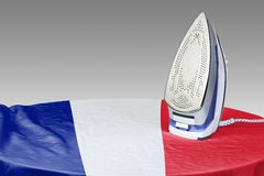 Preparing to smooth out the wrinkles of Flag-France Stock Photos